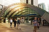 LONDON, UK - MARCH 10, 2014: Canary Wharf business aria. Tube entrance and early morning commuters
