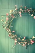 Apple blossom wreath hanging on coat hook
