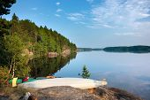 Постер, плакат: Kayaks On The Lake Shore