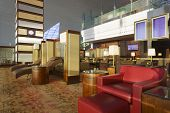 DUBAI - OCT 17: Emirates Lounge in Dubai Airport on October 17, 2013. Dubai Airport is world largest