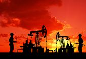 stock photo of oilfield  - two man on oilfield with pump on sunset background - JPG