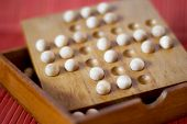 stock photo of brain-teaser  - Wooden brain teaser on the table - JPG