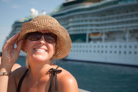 image of cruise ship  - Beautiful Vacationing Woman on Tender Boat with Cruise Ship in the Background. ** Note: Slight blurriness, best at smaller sizes - JPG
