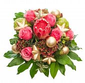 stock photo of christmas flower  - Bouquet of fresh pink roses with golden Christmas decorations isolated on white background. Festive arrangement with exotic flower protea.