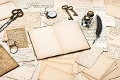 stock photo of nostalgic  - antique accessories old letters open diary book and vintage ink pen - JPG