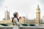 picture of westminster bridge  - London woman drinking coffee by Westminster Bridge - JPG
