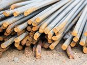 foto of reinforcing  - Stack of steel reinforcement rods for construction background. Selective focus.