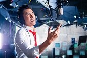 stock photo of recording studio  - Asian professional musician recording new song or album CD in studio - JPG