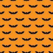 stock photo of bat wings  - Seamless pattern with bats on orange background - JPG