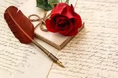 stock photo of feathers  - old letters rose flower and antique feather pen - JPG