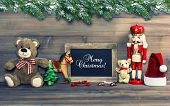 image of nostalgic  - nostalgic christmas decoration with antique toys pine tree branches and blackboard for your text - JPG