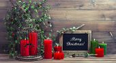 picture of nostalgic  - vintage christmas decoration birdcage red candles and pine branch - JPG