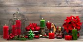 image of xmas star  - vintage christmas decorations with red candles antique baby shoes flower poinsettia stars and baubles - JPG