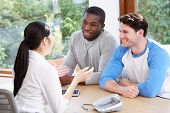 pic of gay couple  - Male Couple Talking With Financial Advisor In Office - JPG