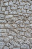 picture of cinder block  - Grungy brick wall texture made of several different stones - JPG