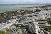 stock photo of long distance  - Rocky coast of Sudhanais Berneray  - JPG