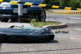 foto of corpses  - Corpse in plastic bag after car accident horizontal - JPG