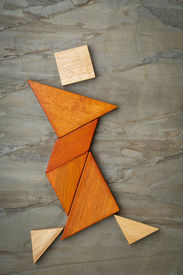 pic of tangram  - abstract figure of a female dancer built from seven tangram wooden pieces - JPG