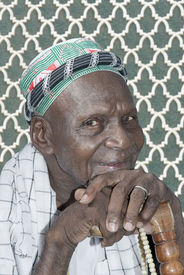 picture of muslim man  - Old Muslim man smiling at the mosque - JPG