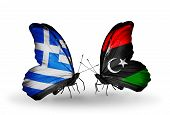 stock photo of libya  - Two butterflies with flags on wings as symbol of relations Greece and Libya - JPG