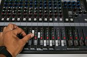 pic of training room  - Hand on a Mixing Desk Fader in Television Gallery - JPG
