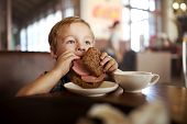 picture of sandwich  - Little boy in a cafe during lunch - JPG