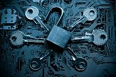 foto of computer hacker  - open security lock on a computer circuit board surrounded by keys  - JPG