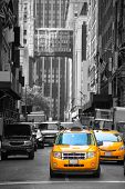 pic of cabs  - Fifth avenue neighborhood yellow cab taxi 5 th Av New York Manhattan USA - JPG