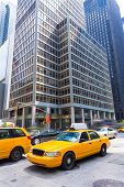 stock photo of cabs  - Avenue of the Americas 6th Av Manhattan yellow cabs New York city US - JPG