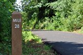 foto of mile  - Mile marker 28 along a paved path for cyclists and joggers - JPG