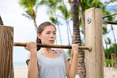 stock photo of pull up  - Fitness woman exercising on chin - JPG