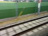 picture of train track  - tracks and rails out in motion from a moving train - JPG