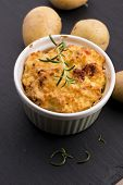 picture of potato-field  - dish of potato souffle with fresh rosemary