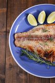 pic of pangasius  - Dish of Pangasius fillet with rosemary and lime on wooden table background - JPG