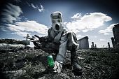 stock photo of gas mask  - Two soldiers in the gas masks and protective clothes are testing biological weapon on the ruined background - JPG