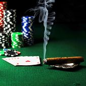 stock photo of cigar  - Cigar chips for gamblings drink and playing cards on green - JPG