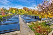 stock photo of graveyard  - Unmarked and unnamed graves on graveyard Mirogoj cemetary of Zagreb - JPG