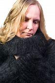 stock photo of snuggle  - Female Model snuggles in a angora sweater - JPG