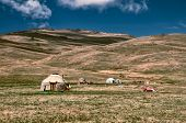 image of yurt  - Traditional yurts of nomadic tribes on green grasslands in Kyrgyzstan - JPG