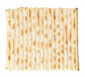 stock photo of piety  - Single machine made matza flatbread piece isolated over the white background - JPG