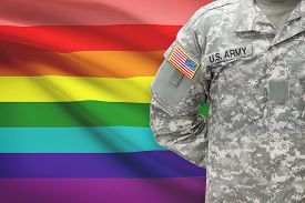 stock photo of transgendered  - American soldier with flag on background  - JPG