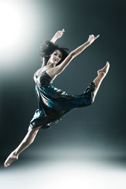 foto of ballet dancer  - Stylish and young modern style dancer is jumping stretched - JPG
