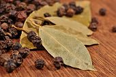 stock photo of peppercorns  - Top view of bay leaves and peppercorns close up - JPG