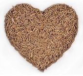 pic of cumin  - Cumin seeds in the form of heart on a white background - JPG