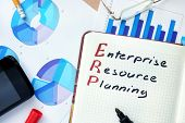 picture of enterprise  - Notepad with word ERP enterprise resource planning concept and marker - JPG