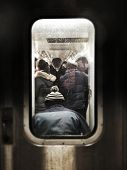 stock photo of commutator  - Instagram filtered image of a crowded subway car with commuters - JPG