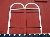 pic of red barn  - Detail of 18th Century red painted barn doors - JPG