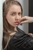 foto of thinkers pose  - sad girl in leather jacket looking in camera - JPG