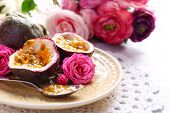stock photo of passion fruit  - Passion fruit on plate on color wooden background - JPG