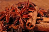 image of cinnamon sticks  - Star anise cinnamon sticks and cloves on a wooden background - JPG